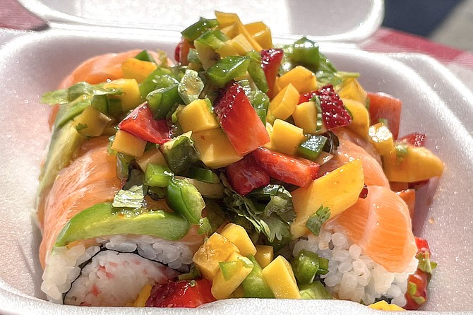 The Lovers Roll: salmon, krab, and avocado, topped with a pile of diced mangos, strawberries, jalapeños, and cilantro
