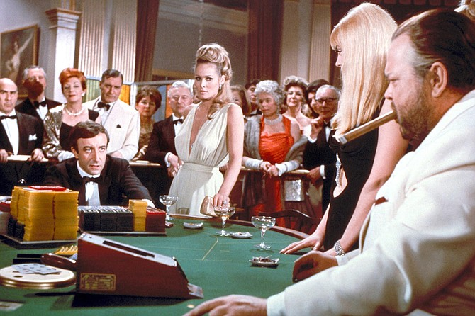 Casino Royale: Ursula Andress runs interference between a feuding Peter Sellers and Orson Welles.