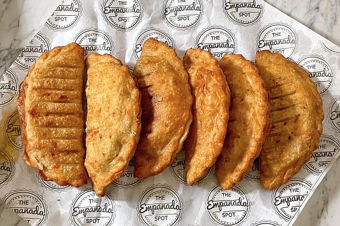 A collection of braided, near-perfect empanadas from upstart Empanada Spot