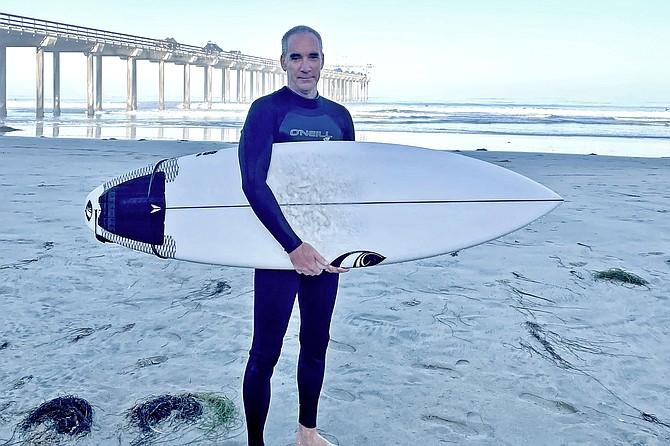 52-year-old Private Investigator Dave O'Connor surfs Scripps pier.