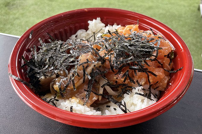A medium (two scoop) poke bowl featuring garlic salmon poke and ahi poke with oyster sauce