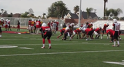 Footage of the field at Hoover High, cheerleading and football practice, and a chat with some players.