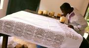 Traditional batik printmaking in a Dar es Salaam shop.