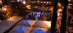Balcony view of a festival in Madrid's Plaza de Santa Ana.