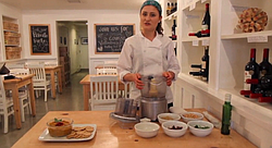 """Vegan chef Katie Gluck of <a href=""""http://katieshealingkitchen.com"""">Katie's Healing Kitchen</a> creates a vegan dish from scratch at the Wine Vault and Bistro."""
