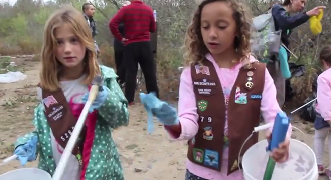 San Diegans of all ages contribute to the Creek to Bay Cleanup event by cleaning up garbage in the San Diego River area.