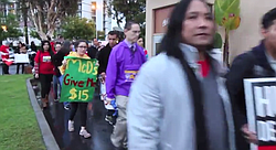 Fast food workers rally in San Diego to call for a higher minimum wage.