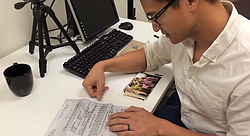 Tam translates the documents for his father's release from a reeducation camp in Vietnam.