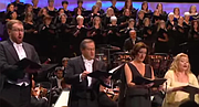 """If you want to hear validation about the text being secondary in a mass, listen at the 3:00-minute mark to Sir Colin Davis. However, the chorus hits the """"k"""" pretty hard, but the soloists all basically start on an """"ih"""" vowel and just skip the """"k""""."""