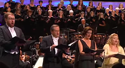 "If you want to hear validation about the text being secondary in a mass, listen at the 3:00-minute mark to Sir Colin Davis. However, the chorus hits the ""k"" pretty hard, but the soloists all basically start on an ""ih"" vowel and just skip the ""k""."