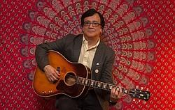 ...playing John Lennon's J160e guitar