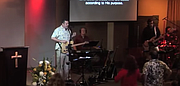 Brendan Prout leads worship with Cynthia Pratt, Murray Judy, Steve Williams, and Asher McCormick at San Diego Community Bible Church main services on June 1, 2014.