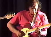 ...Wayne Riker on guitar