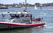 Man with injured arms pulled out by Coast Guard