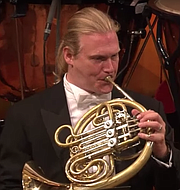 The Norse god Thor plays French horn.